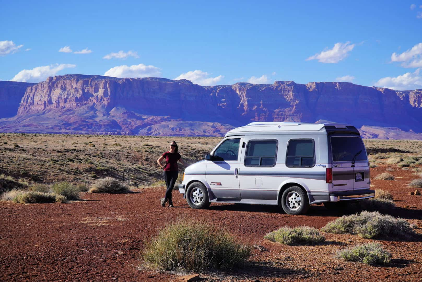 Kristin and her Chevy astro in Arizona, where she does freelance remote work from anywhere