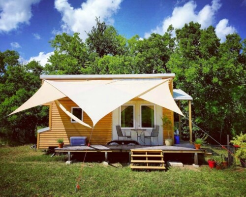 Home built from The Tiny Project floor plans with canopy.