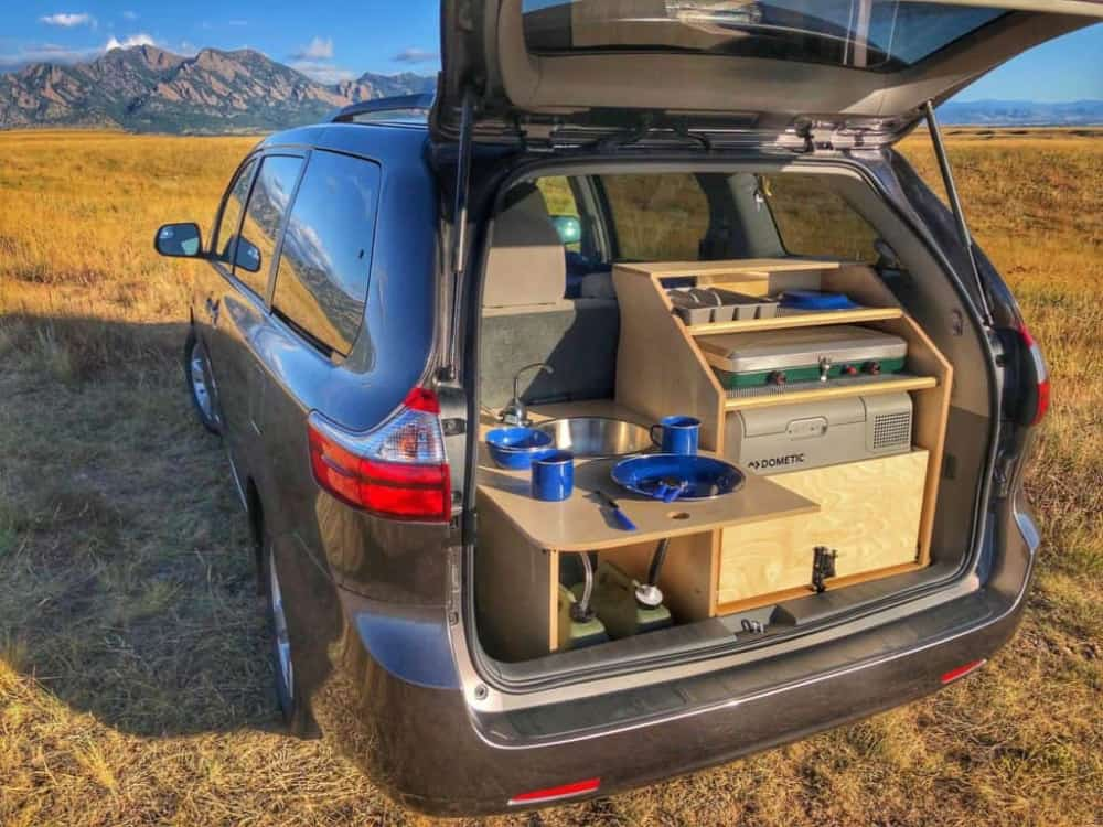 View into the trunk of a minivan camper converted with Contravan's conversion.