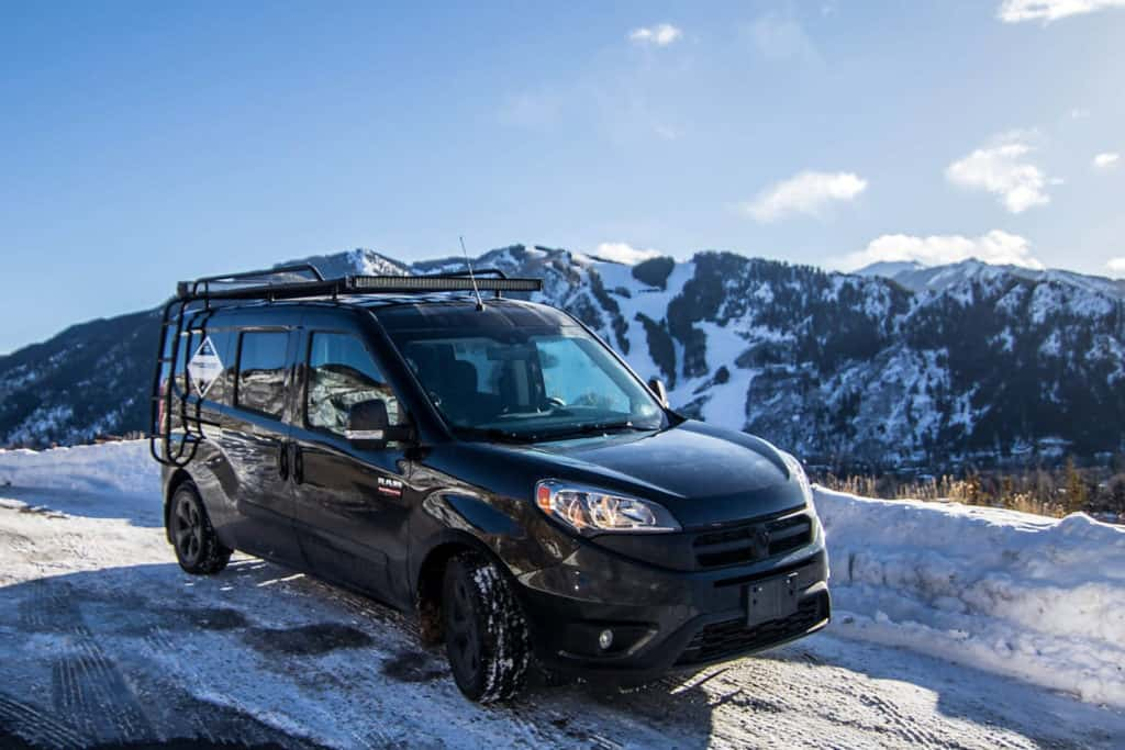 Dodge Promaster City parked in the snowy mountains is a small cargo van you can live in.