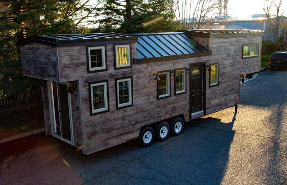 The Paradise tiny house for sale in California parked on the street.