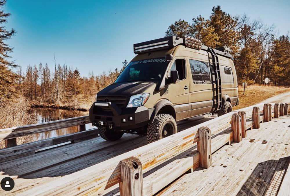 Sprinter camper van crossing a wooden bridge