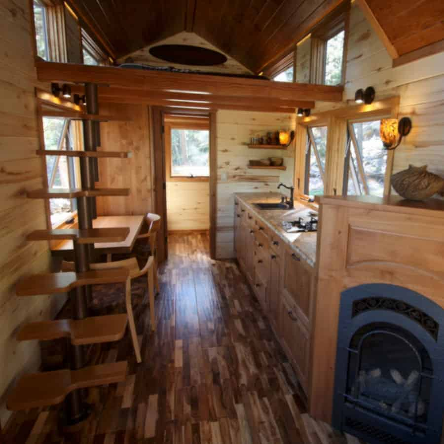 Interior of the Aspen DIY tiny house with sleeping loft, stairs and kitchen