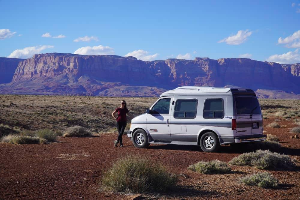 Chevy Astro small campervan in front of Vermillion Cliffs