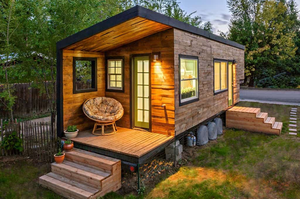 Tiny house on wheels with front and back deck