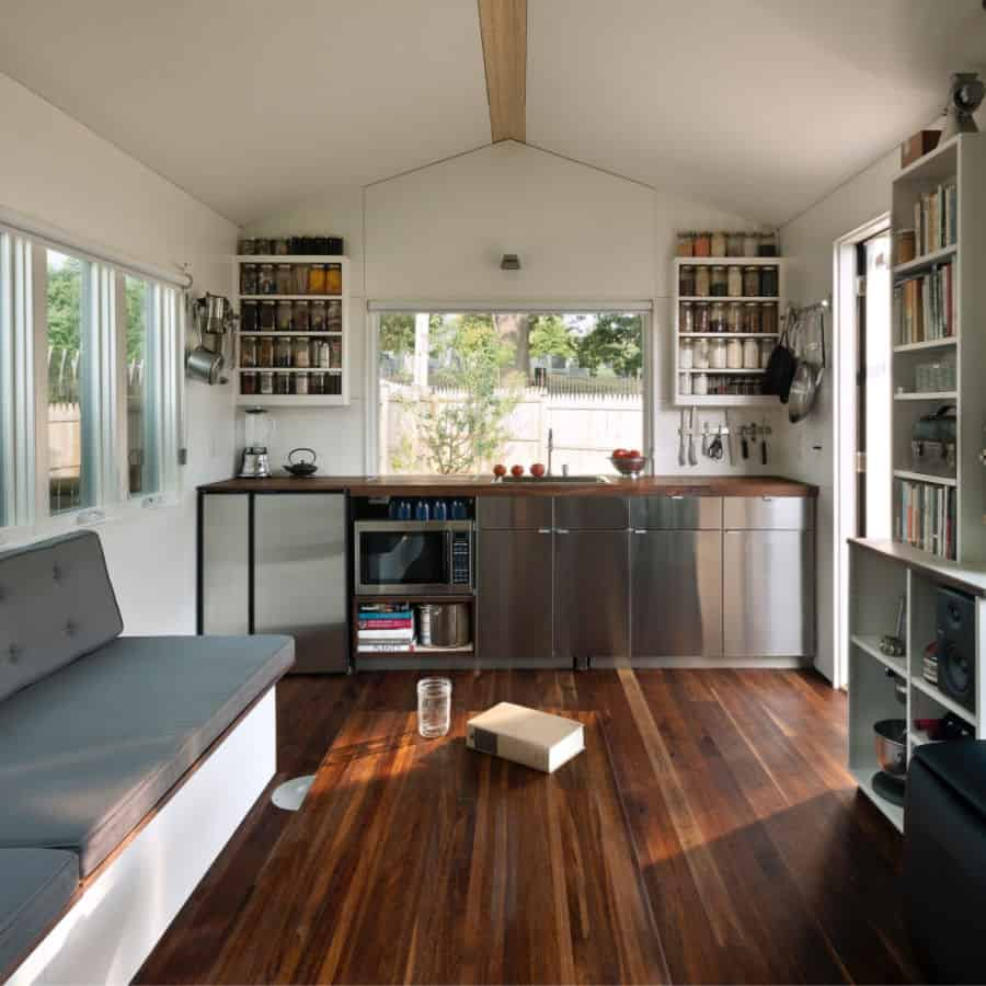 Interior of the Minim DIY tiny house with 10' galley and seating area