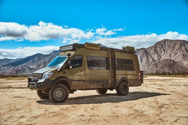 Green sprinter 4x4 camper van parked in the desert