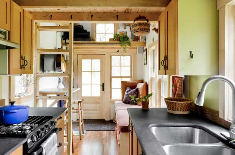 Interior of Vermont Tiny house with kitchen, stairs to loft and sitting area