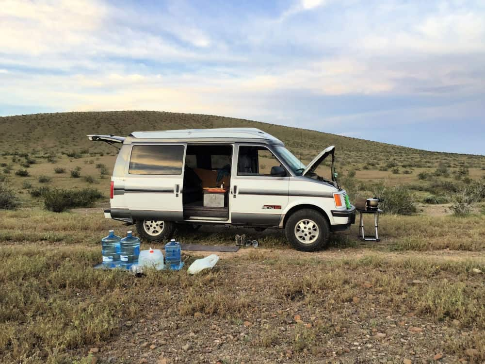 Astro van camper conversion parked in an outdoor camping spot