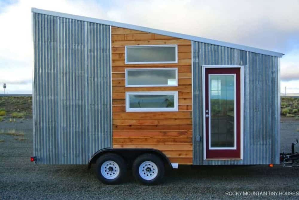 Front view of steel and wooden sided affordable tiny house on wheels.