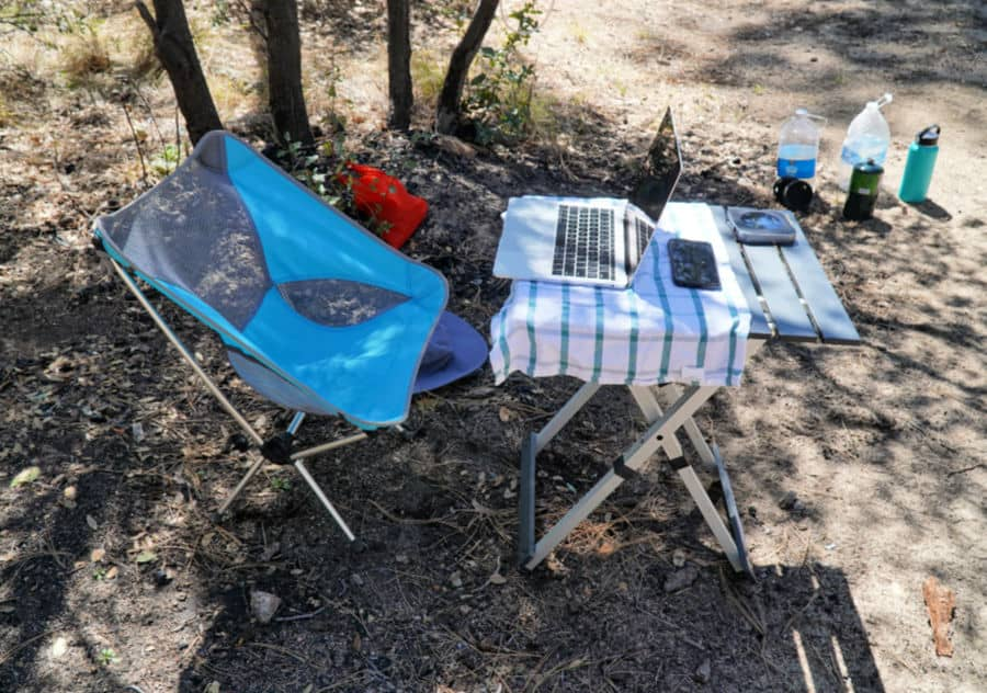 Camping chair and table set up for working using van life WiFi