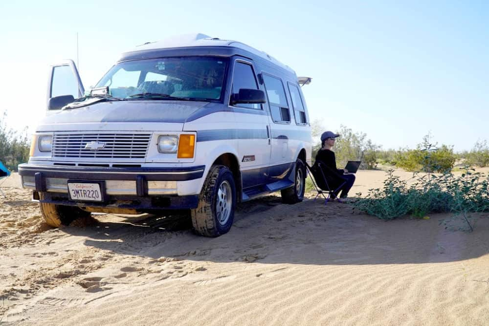Sitting by my campervan working remotely in the Imperial Sand Dunes