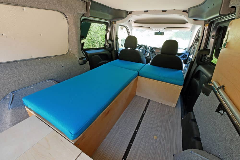 Wally Dodge City Cargo Van Conversion Kit with Teal Bed and folding table
