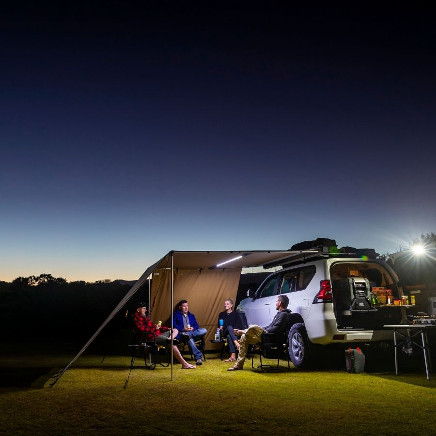 ARB van awning with LED light strip used at night.