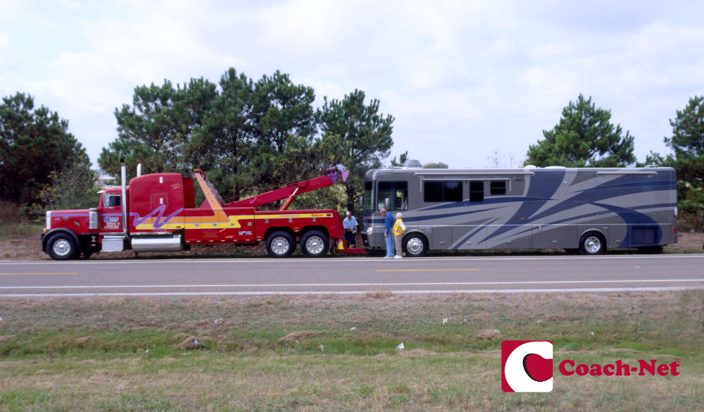 Coach Net RV roadside assistance Tow trucked attached to a Class A RV
