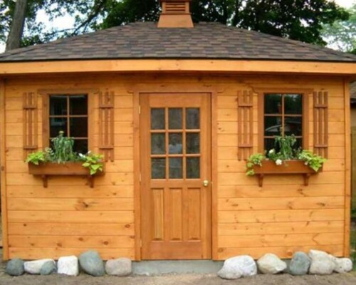 Quaint Sonoma cabin cheap tiny house kit built with wood planking and wooden shutters and window boxes.