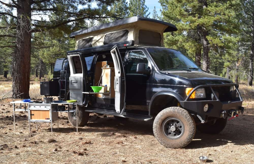 Trail Kitchens conversion kit set up both in and outside a van.