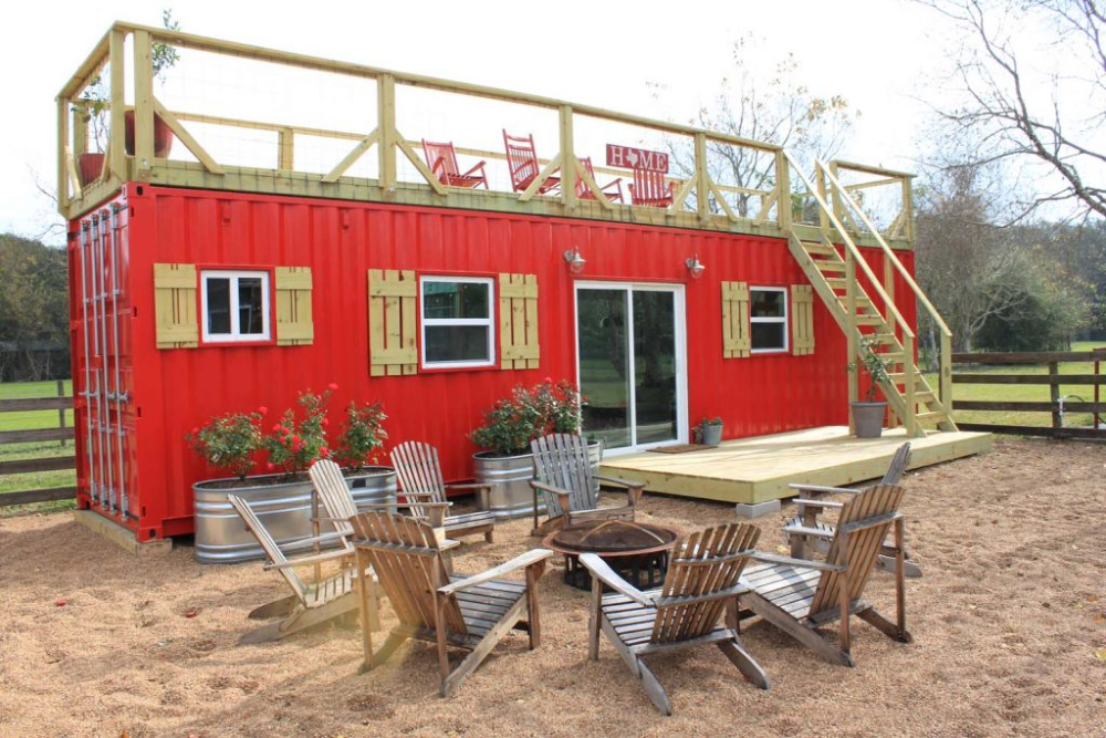 Backcountry Containers Rustic Retreat XL red shipping container home with rustic wooden finishes.