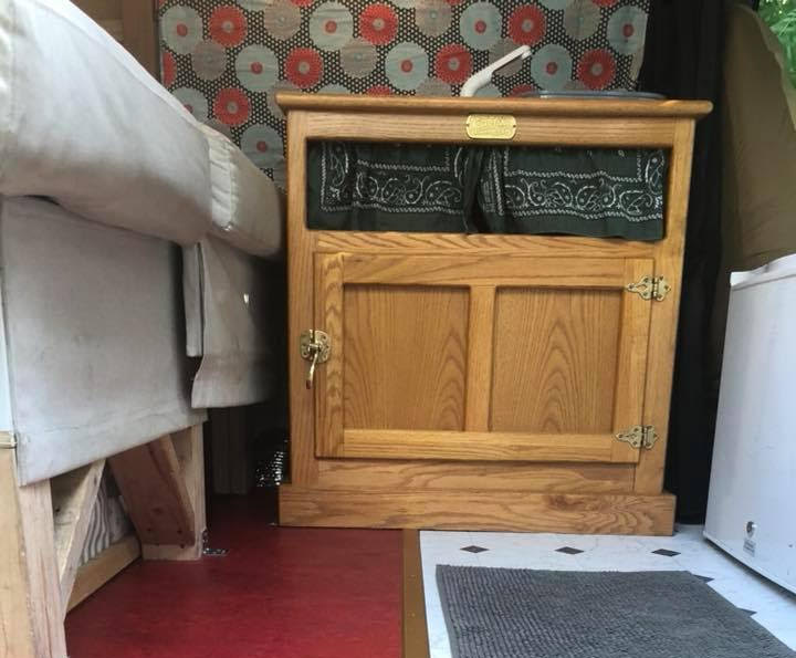 Kitchen cabinet inside a Ford Econoline camper conversion