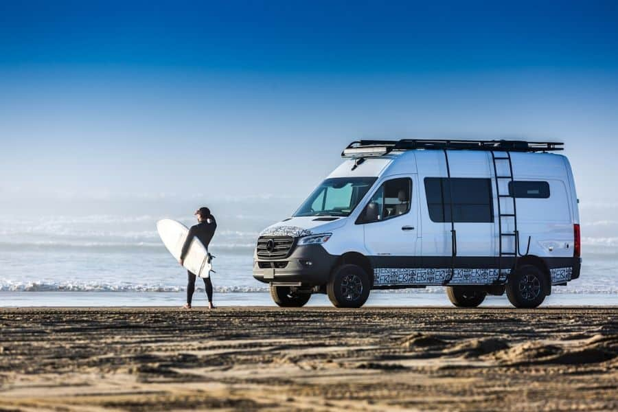 Kapitan van conversion on a beach with a surfer standing nearby