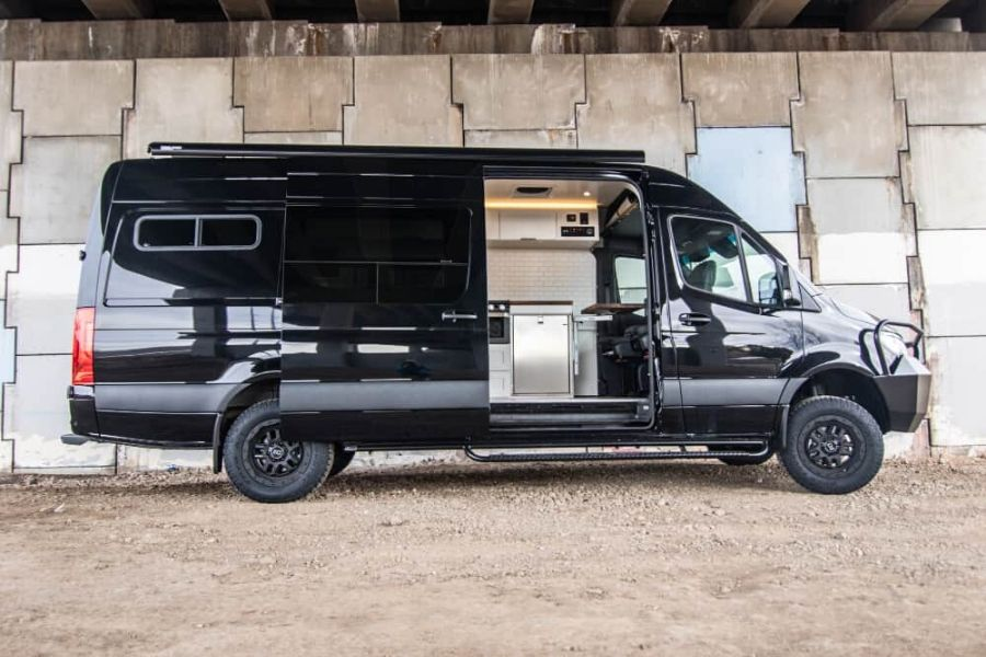 Rossmönster Vans conversion with sleek black siding and side door view of stainless steel fixtures