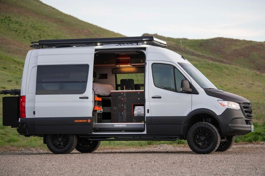 Sync Vans van conversion exterior view with side door open and grey ad orange accents showing