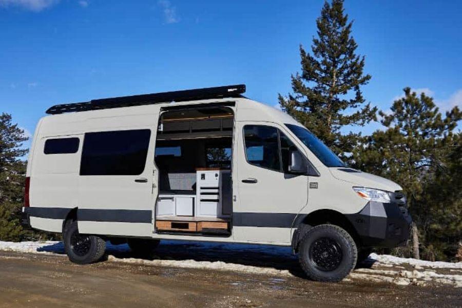 TouRig camper van conversion company converted van view with side door open into kitchen