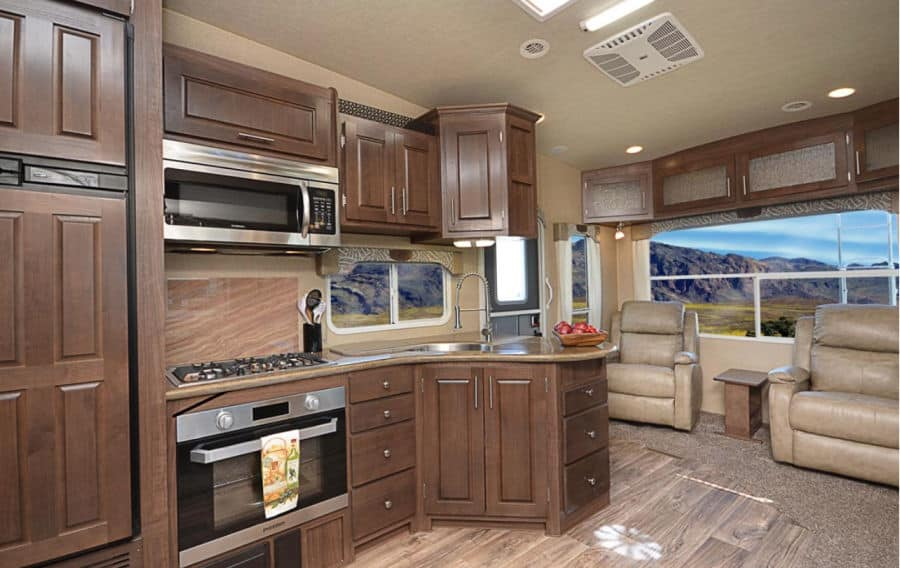 Arctic Fox 5th wheel interior with a large kitchen and sitting area