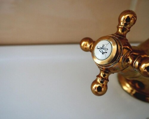 Brass hot water tap in a bathtub