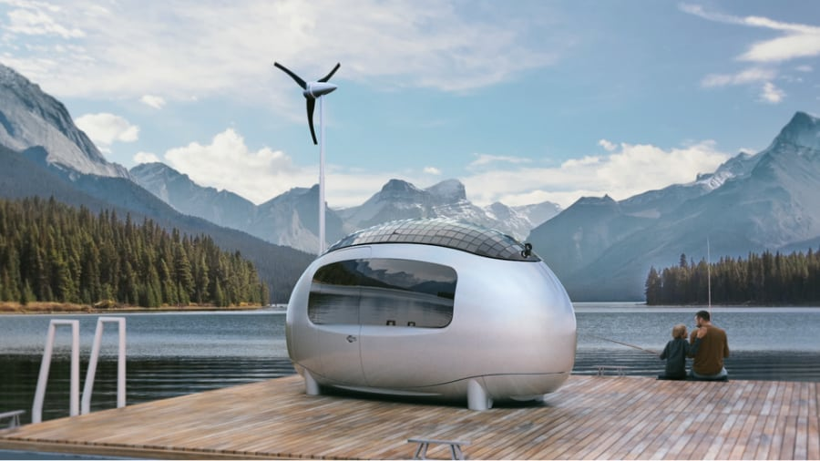 The Ecocapsule off-grid tiny house parked on a pontoon in a lake