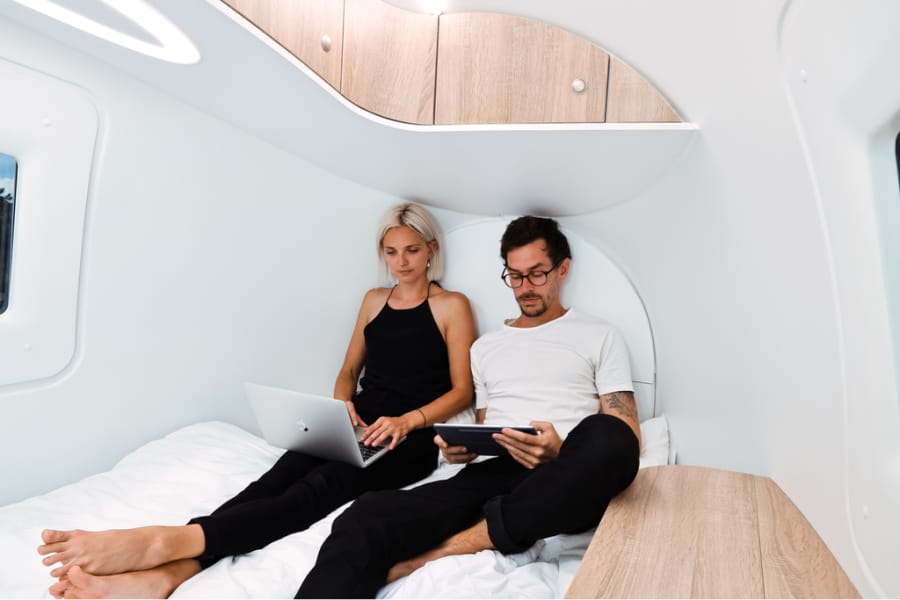 Two people working inside the Ecocapsule off grid tiny home
