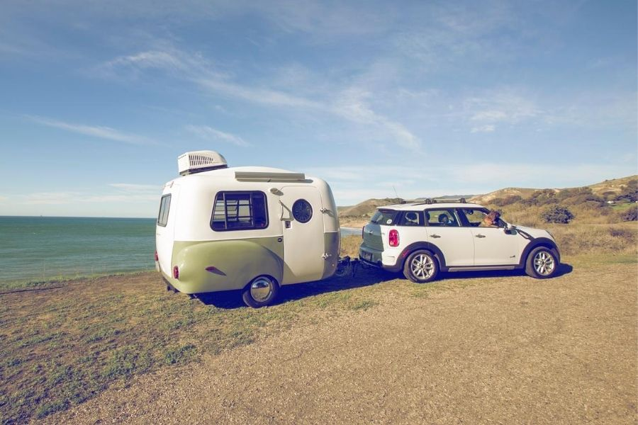 HC1 micro camper by Happier Camper parked along the beach
