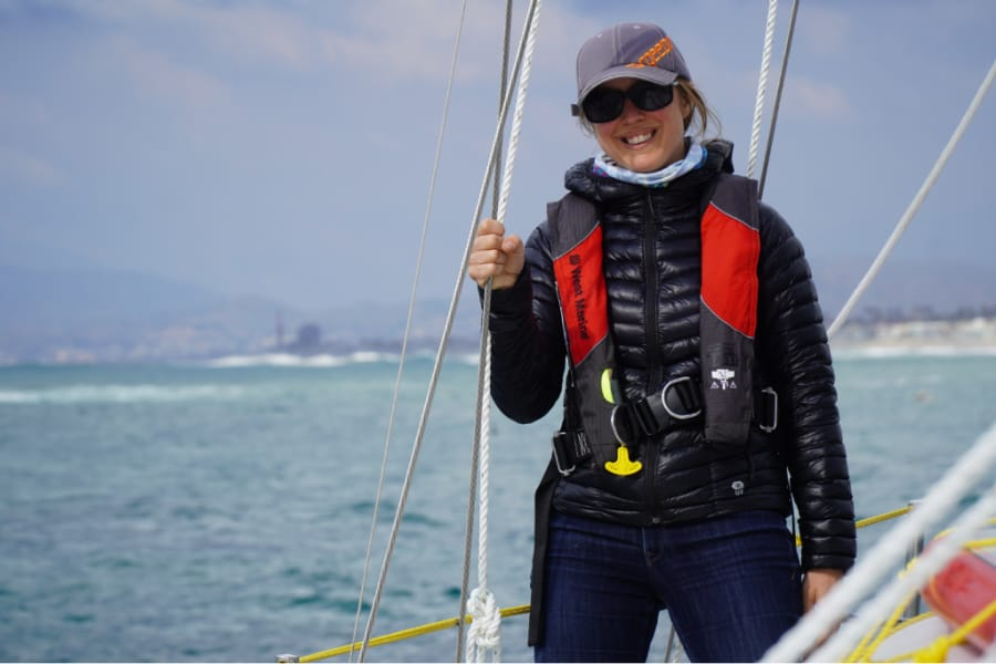 Woman wearing a puffy coat for sailing