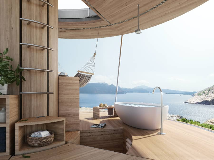 Interior of the Ojala off grid tiny home with a bathtub, hammock and views