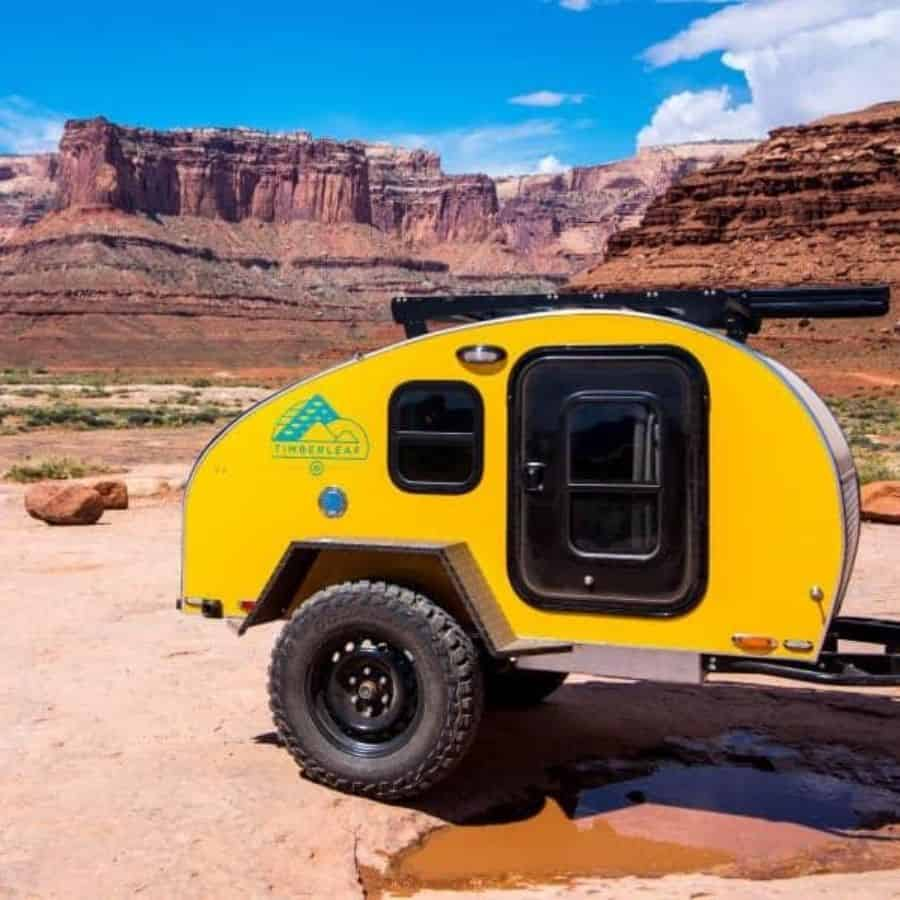 Yellow Pika micro camper by Timberleaf in mountainous terrain