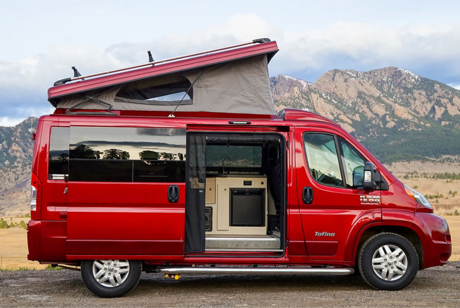 Red Pleasure Way Tofino Class B RV with top popped and mountains behind