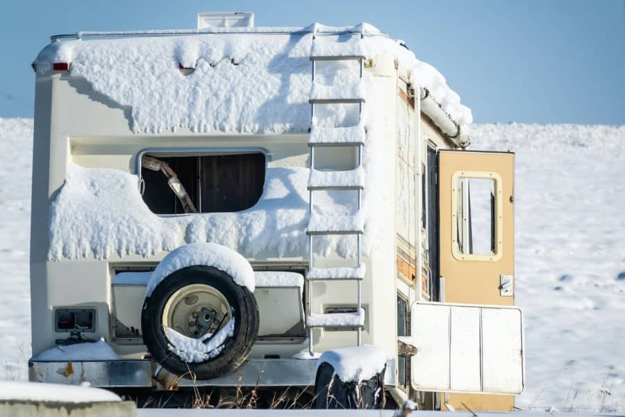 RV covered in snow - the best RV heater is essential in winter
