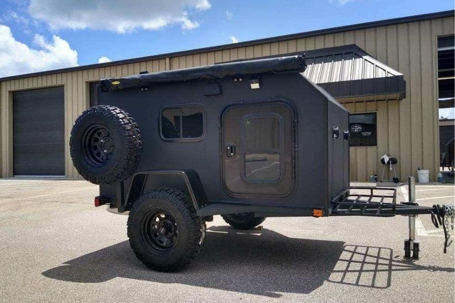 Rugged Rhino micro camper by Tiny Camper Company with spare tire mounted on side