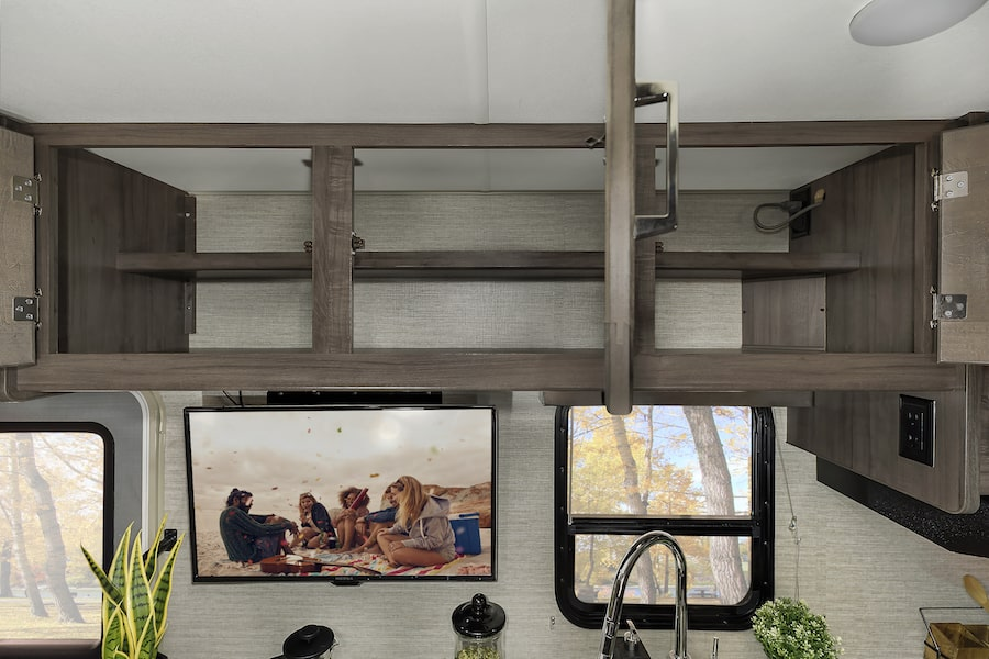 Storage space above the sink in an RV for fulltime living