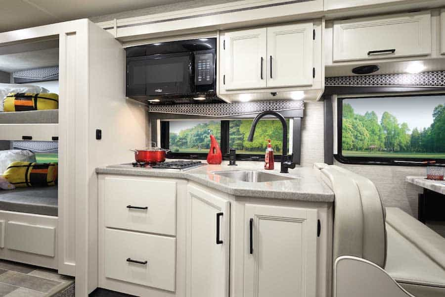 The cozy interior and kitchen area of this best RV for full time living