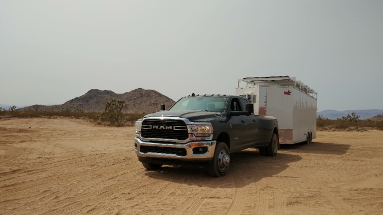 Pickup truck and RV camping on their own land