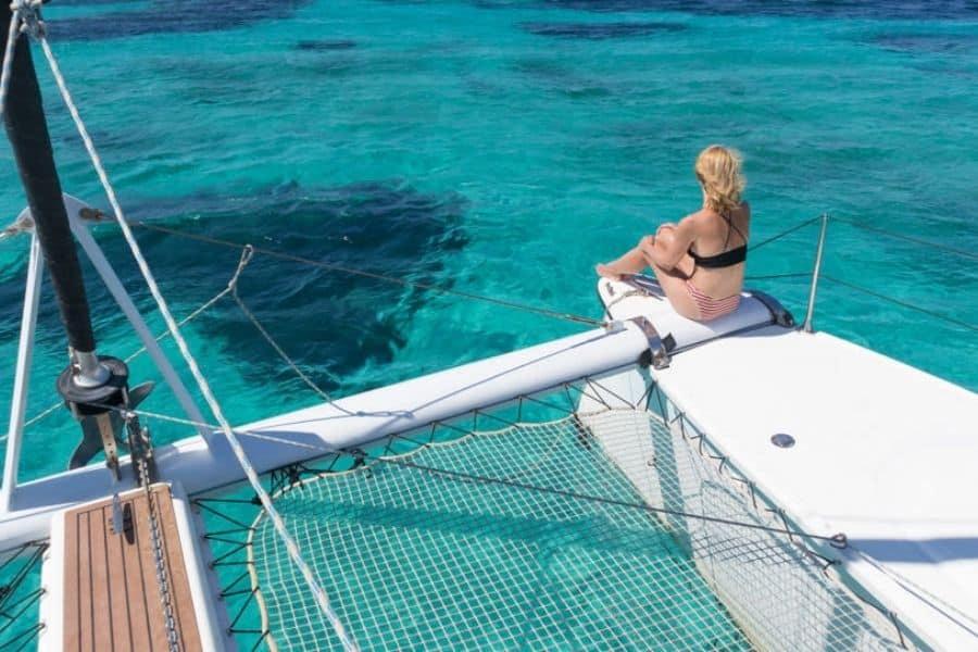 Woman on a catamaran on the ocean