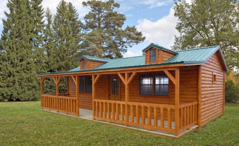 Wildcat Barns portable log cabin rent to own tiny home with deck