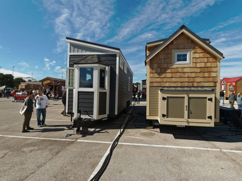 Tiny houses on wheels displayed in a lot for people to view