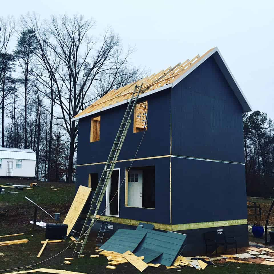 Blue Tuff Shed Tiny House under construction on a piece of property