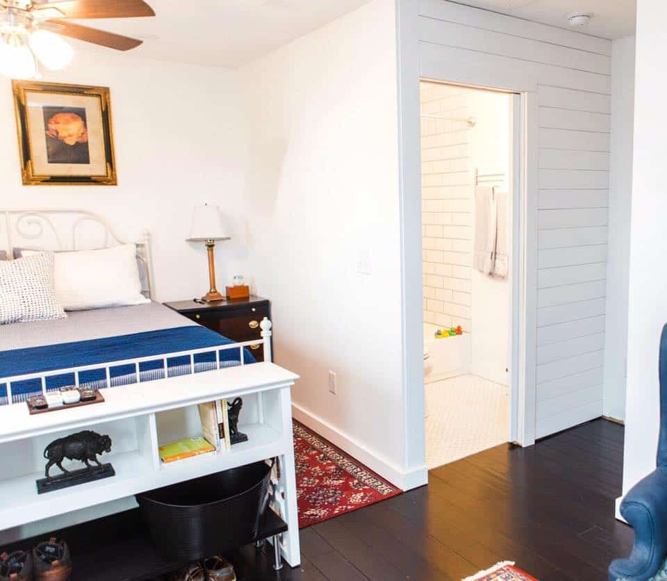 Bedroom and bathroom upstairs in a Tuff Shed tiny house