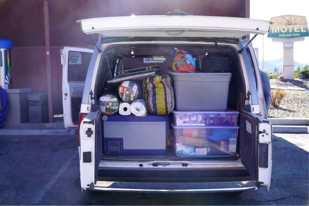 Bins full of stuff in the back of a van - staying organized while living in a car