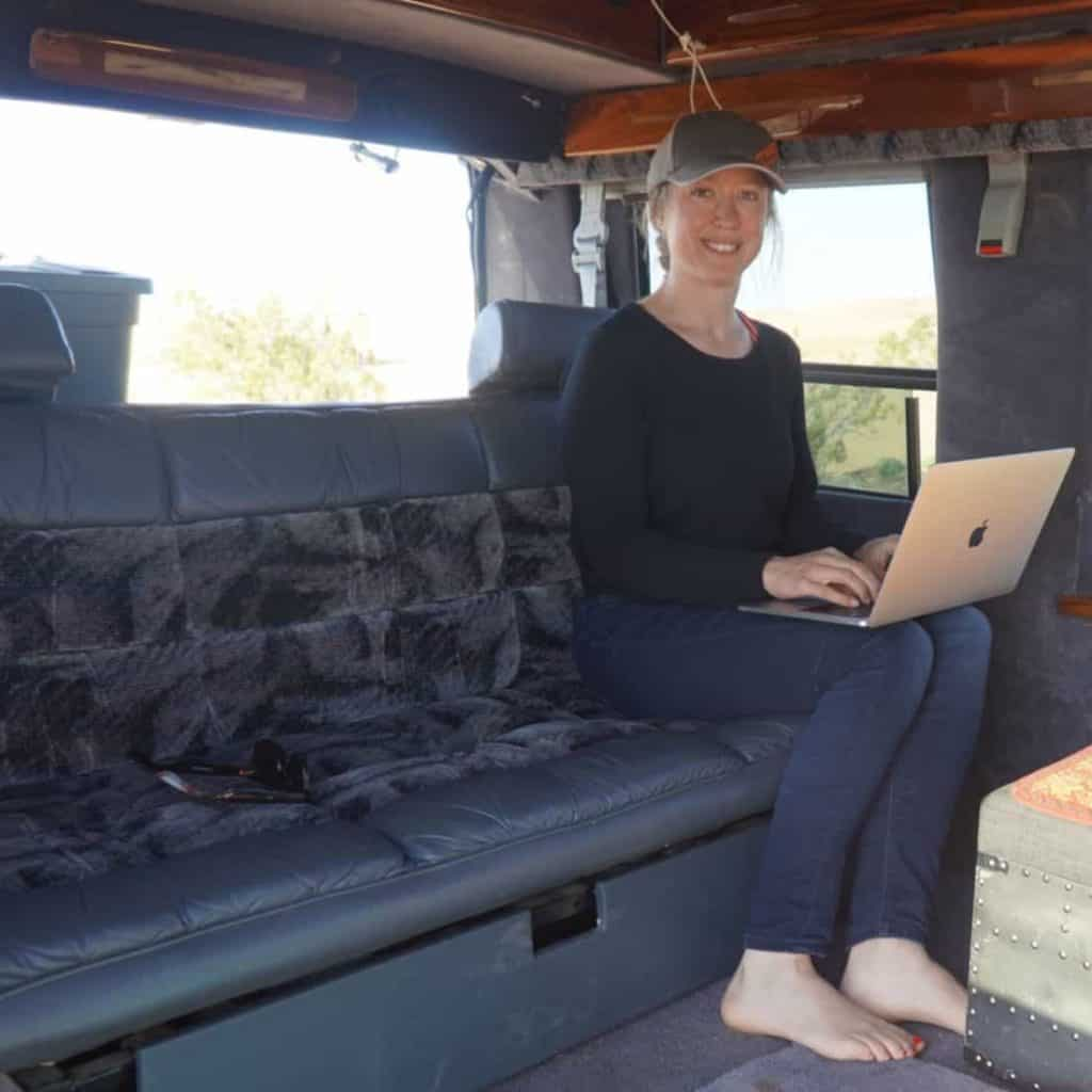 woman using Wifi to Work while Living in a car
