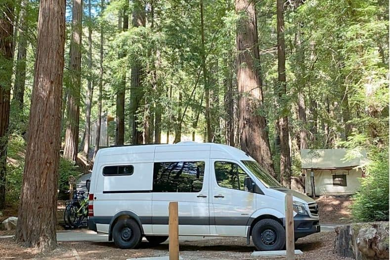 Camper van parked in the woods