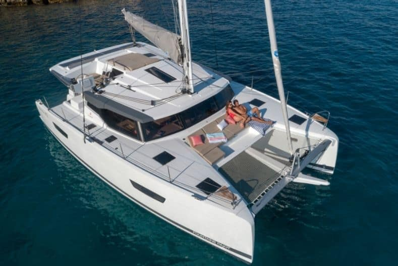 Catamaran vs Monohull: Catamaran with people seated on deck